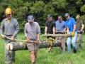 Bridge building crew, moving logs