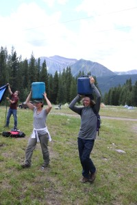 Transporting water to camp