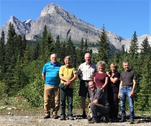 """GDTA """"Originals"""" on July 2019 Signature Trip. L – R: Lani Smith, Cliff White, Dave Higgins, Jeff Gruttz (kneeling), Jenny Feick, Mary Jane Kreisel (nee Cox) and Dave Zevick. (Photo by Margaret Dumigan)"""