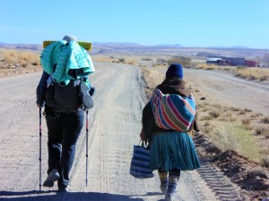 Fidgit Walking with an Aymara Woman, in the Alti-Planos (high plains) of Bolivia