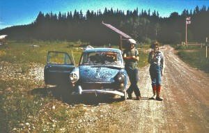 """Jenny Feick and Chris Hart with 'Old Blue"""" the infamous VW from Project: Great Divide Trails (after the windshield was replaced), at the US/Canada border in the Flathead Valley, B.C., July 1974. (Photo by Dave Higgins)"""